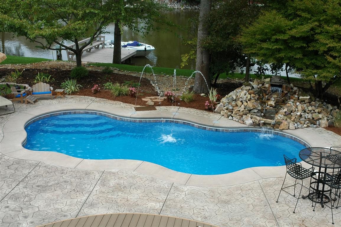 Laguna freeform inground fiberglass pool 71a calm water Fiberglass swimming pool installation