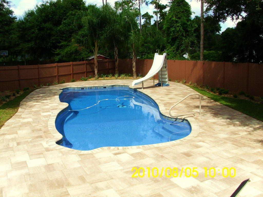 Custom tile work viking fiberglass inground swimming pools for Custom inground swimming pools