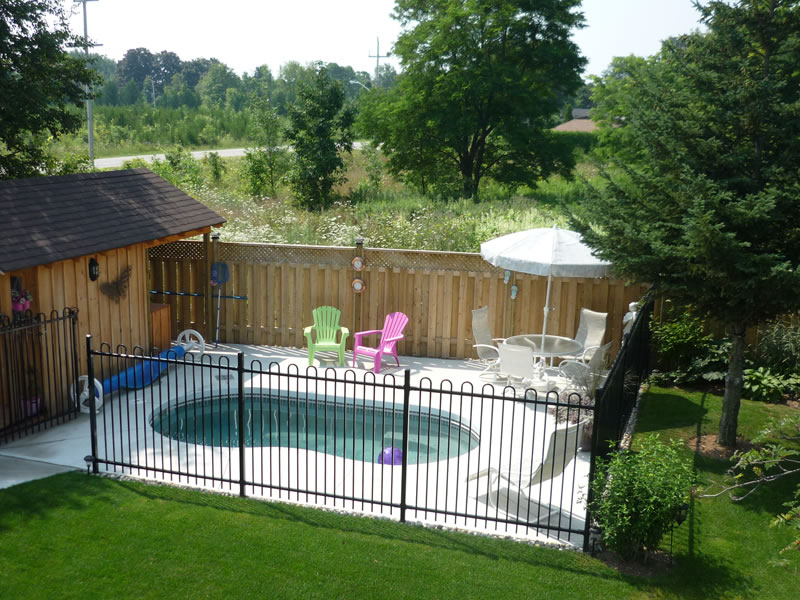 inground pool with hot tub waterfall small fiberglass viking in ground pools for backyards cost